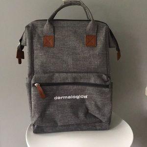 Grey Dermalogica backpack 🎒